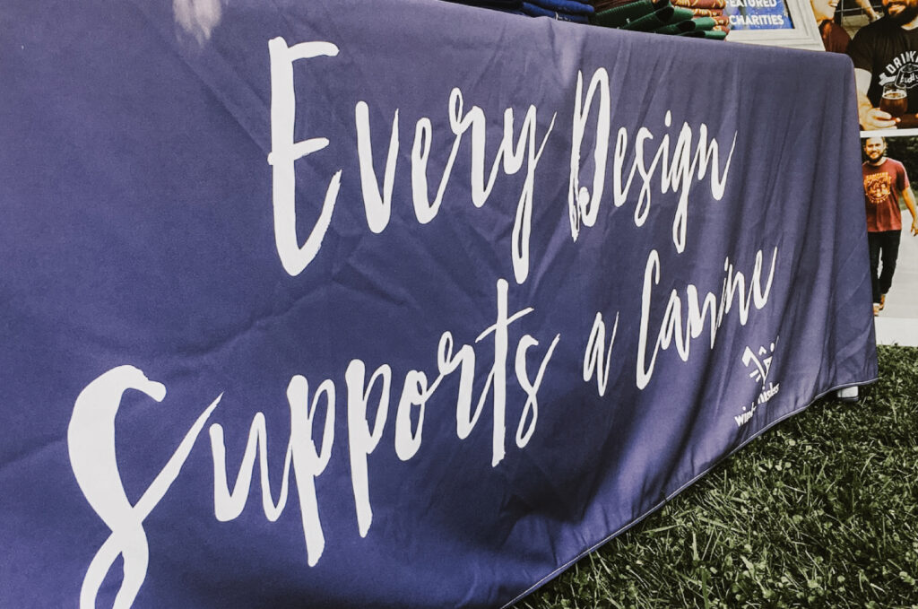 Every design supports a canine slogan printed on table cloth