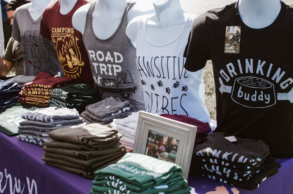 Merchandise spread out on table while selling at events traveling full time
