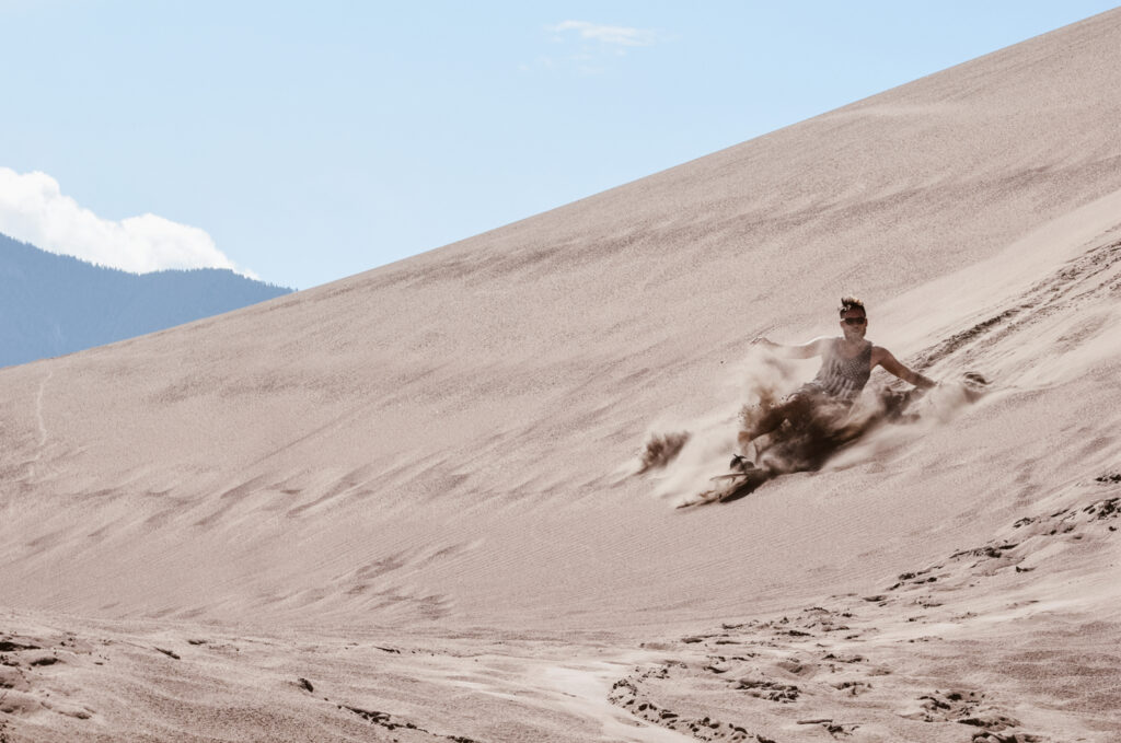 Sand Surfing at Great Sand Dunes National Park and Preserve